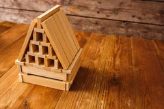 Wooden Block House on wooden table Royalty Free Stock Photos
