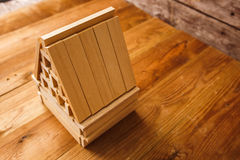 Wooden Block House on wooden table Stock Photos