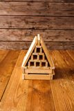 Wooden Block House on wooden table.  Stock Photo