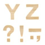 Wooden block letter set isolated. Set of handmade block wooden letters Y and Z, and multiple symbols isolated over the white background Royalty Free Stock Photo