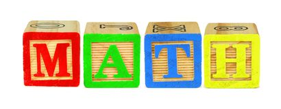 Wooden block letters spelling MATH over white. Wooden toy letter blocks spelling MATH isolated on white royalty free stock photo