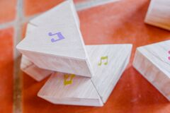 Wooden block with musical notes to learn children music theory