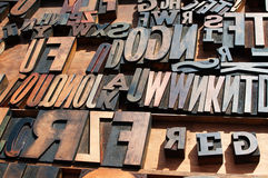 Wooden block printing press letters. A bunch of old vintage wooden block printing press letters Stock Photography