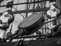 Wooden block or pulley on traditional sailing vessel Stock Image