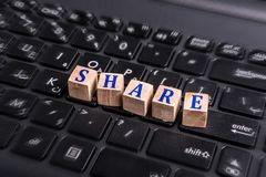 Share on laptop stock photo