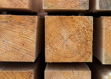 Wooden block square part warehouse of building materials beige pattern. Close-up Stock Images