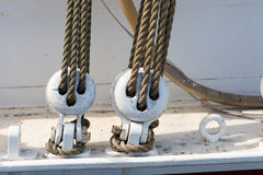 Wooden block tackle marine rigs and ropes Royalty Free Stock Photos