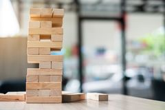 Wooden block tower on office background stock photo