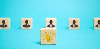 Free Wooden Block With An Idea Light Bulb Icon And A Team Of Workers. A Collective Innovate Idea Concept. Cooperation, Teamwork. Stock Photography - 213032752