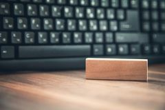 Wooden block on the wood with keyboard background. N Business concept Stock Photos
