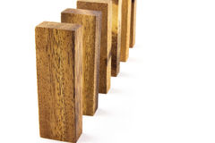 Wooden blocks arranged in a row Royalty Free Stock Images