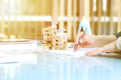 Wooden Blocks arranged in two piles on the table. Stock Photography