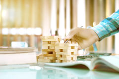 Wooden Blocks arranged in two piles on the table. Stock Images