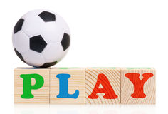 Wooden blocks. Arranged in the word PLAY and small soccer ball - isolated on white background Royalty Free Stock Photos