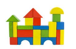 Wooden blocks castle. A castle house - castle created of colorful wooden toy blocs in red, yellow, green and blue, isolated on white Stock Photo
