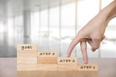 Wooden blocks with hand walk go to stair to goal Stock Photo