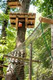 Obstacle path suspendend in adventure playground Royalty Free Stock Image