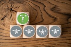 Wooden blocks with icons of bodybuilders