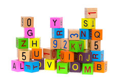 Wooden blocks with letters. And numbers on white background Royalty Free Stock Photo