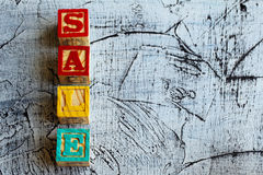 Wooden blocks with the letters `sale`. And an aged  background Stock Image