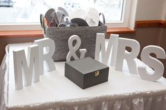 Mr and Mrs. Wooden blocks with letters signifying wedding or marriage, with box and sandals displayed stock photos
