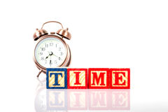 Wooden blocks with the letters time and a clock Royalty Free Stock Photography
