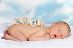 Wooden blocks on newborn boy Stock Photography