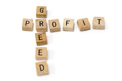 Wooden blocks with profit greed words isolated Stock Photos