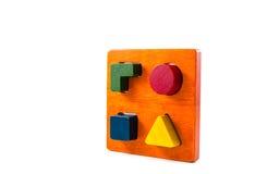 Wooden blocks shape sorter toy. Isolated on white background Stock Photos