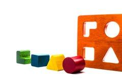 Wooden blocks shape sorter toy. Isolated on white background Royalty Free Stock Photo