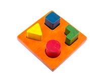Wooden blocks shape sorter toy. Isolated on white background Stock Images