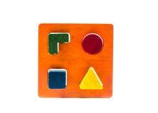 Wooden blocks shape sorter toy. Isolated on white background Stock Photo