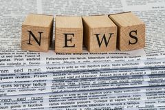 Wooden Blocks Spelling News On Newspapers Royalty Free Stock Photos