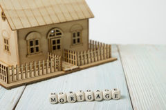 Wooden blocks spelling the word Mortgage Stock Photo