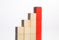 Wooden blocks in stairs with red ones showing growth Stock Photography