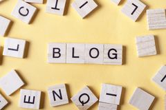 Wooden blocks with the word BLOG. Wood ABC.