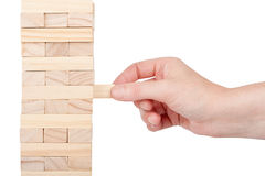 Wooden blocks tower and a hand Stock Photos