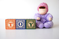 Wooden blocks toy and doll Royalty Free Stock Photo