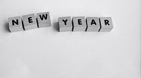 Wooden blocks on white background spelling NEW YEAR. Wooden blocks on a white background spelling NEW YEAR Royalty Free Stock Image