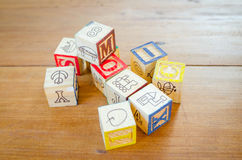 Wooden blocks on wooden table Stock Photography