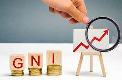 Wooden blocks with the word Gni and up arrow. Gross national income is the sum of a nation`s gross domestic product and the net. Income it receives from royalty free stock photos