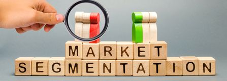 Wooden blocks with the word Market Segmentation and multicolored groups of people. Target audience, customer care. Market group of. Buyers. Customer analysis stock photography