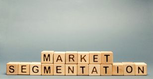 Wooden blocks with the word Market Segmentation. Target audience, customer care concept. Market group of buyers. Customer analysis. Customer relationship royalty free stock image