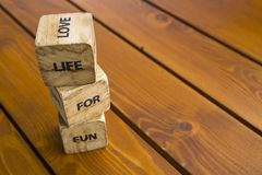 Wooden blocks with the words lie on the table. Wooden cubes with letters and symbols. Life for love. Wooden blocks with the words lie on the table. Wooden cubes stock images