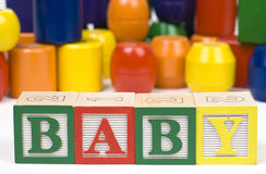 Wooden Blocsks Spelling Baby Stock Image