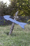 Wooden blue arrow in the courtyard stock photography
