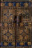 Antique wooden blue and brown geometric design window shutter royalty free stock images