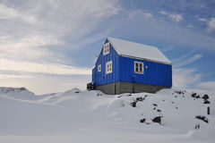 Wooden blue cabin in winter. Houses in the Kulusuk village, Greenland Royalty Free Stock Image