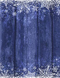 Wooden blue christmas background with snowflakes, vector Stock Image