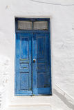 Wooden blue door in greece Royalty Free Stock Image